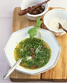 Herb soup with olive oil, croutons and Parmesan