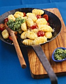 Basil gnocchi with cocktail tomatoes and Parmesan