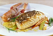 Catfish and Norway lobster with vegetables and lemon sauce