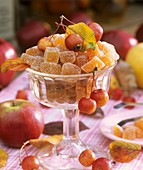 Pieces of sugared apple jelly in stemmed glass bowl