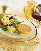 A slice of goose liver pâté with salad