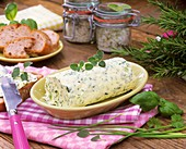 Home-made herb butter in small dish on table