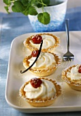 Small shortcrust pastry tart cases filled with vanilla cream