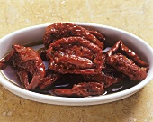 Small dish of dried tomatoes in oil