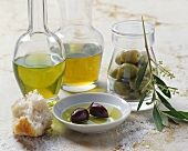 Still life with olives and different types of olive oil