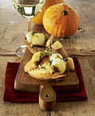 Pearl onions on toasted baguette, pumpkins