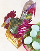 Mexican tin rooster with coloured eggs