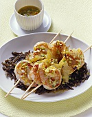 Prawn and carambola skewers with chilli and wild rice