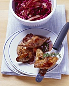 Roast quail with red cabbage salad and quince vinaigrette