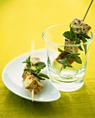 Cubes of vegetable omelette and herbs on skewers