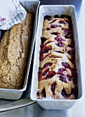 Banana cake and plum cake in two loaf tins