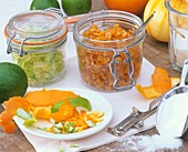 Candied orange and lime peel in preserving jars