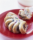 Iced cockscomb (pastry) with sprinkles
