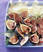 Appetiser platter with fresh figs, prosciutto and cheese
