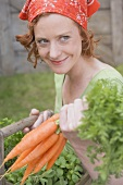 Young woman with carrots