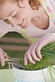 Young woman cutting chives