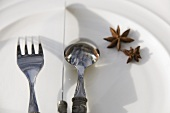 A place-setting with star anise on a plate