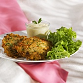 Fish and potato cakes with lollo bianco and yoghurt dip