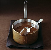 Melted chocolate in a copper pan