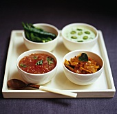 Four different sauces and chutneys