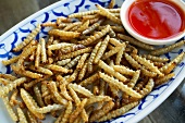 Deep-fried bamboo worms with chilli dip (Thailand)