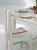 Set dining table with loose cover on chair
