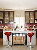 View into a kitchen with bar stools