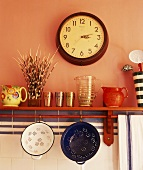 Crockery and colanders on shelf