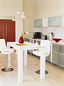 Dining table with two bar stools in kitchen