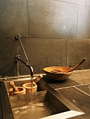 Wooden bowls & two wooden mortar and pestle sets in sink