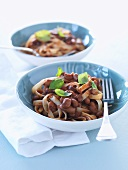 Ribbon pasta with tomatoes, beans and basil