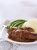 Sausages with onion gravy, mashed potato and green beans