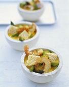 Green coconut curry with Norway lobster, cod and asparagus