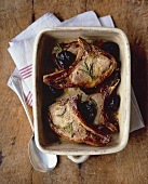 Marinated wild boar chops with prunes in Armagnac