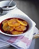 Oranges in red wine