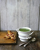 Spinach and watercress soup with cheese on toast