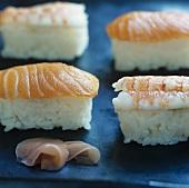 Four nigiri sushi with salmon and prawns