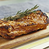 Roast belly pork with crackling on chopping board