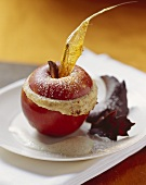 Stuffed baked apple with chocolate leaves