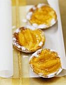 Three orange and walnut tarts