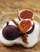 Fresh figs, sugar and cinnamon stick
