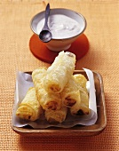 Fried banana spring rolls with cinnamon yoghurt