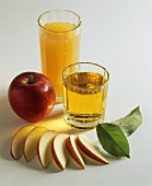 Two glasses of apple juice and apples