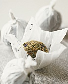 Balls of dried tea leaves in paper