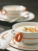 Cream of asparagus soup with smoked salmon