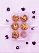 Plum muffins with pansies