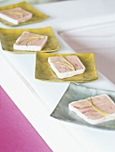 Slices of terrine on dishes