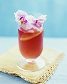 Hibiscus sangria with orchid decoration