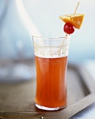 Singapore Sling made with gin, pineapple juice & cherry brandy