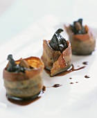 Bacon-wrapped figs sprinkled with port wine